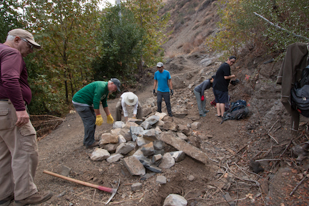 Volunteers moving rocks